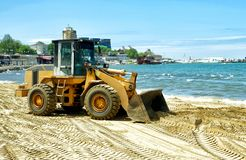 Tractor on the sea beach Stock Image