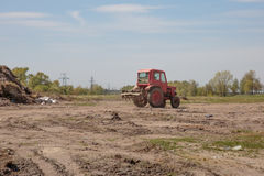 Tractor with seedbed cultivator as part of pre seeding activities Royalty Free Stock Image