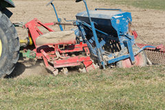 Tractor with seeder Stock Photo