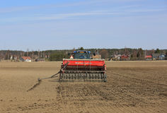 Tractor and Seeder on Field at Spring Stock Photography