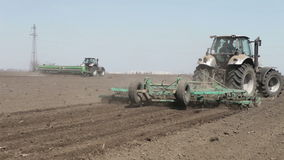 Tractor and seeder machine stock video