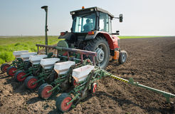 Tractor and seeder stock photos
