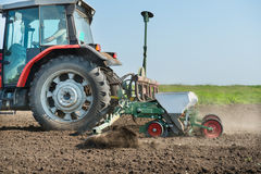 Tractor and seeder Royalty Free Stock Photo