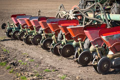 Tractor and seeder planting Royalty Free Stock Image