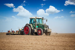 Tractor and seeder planting Royalty Free Stock Photo