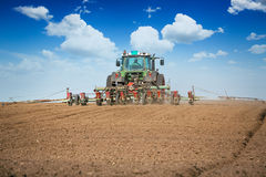 Tractor and seeder planting Royalty Free Stock Photos