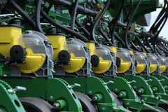 Tractor and seeder planting crops on a field Stock Photos