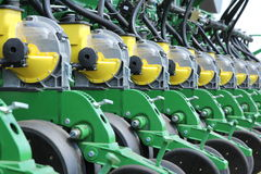 Tractor and seeder planting crops on a field Royalty Free Stock Photo