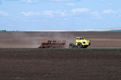 Tractor with seeder, sowing works Stock Photo