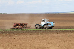 Tractor with seeder, sowing works Stock Image