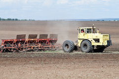 Tractor with seeder, sowing works Stock Photography