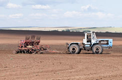 Tractor with seeder, sowing works Stock Images