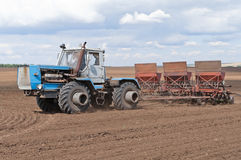 Tractor with seeder, sowing works Royalty Free Stock Photography
