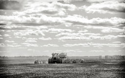 Tractor and seeding drill on a field Stock Photos
