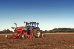 Tractor seeding in a field Royalty Free Stock Photo