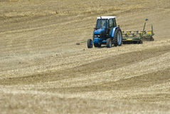 Tractor Seeding Field Stock Photography