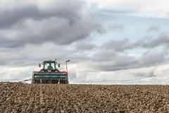 Tractor seeding in a field Stock Images