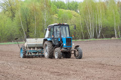 Tractor seeding the field Royalty Free Stock Images