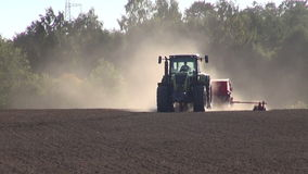 Tractor seeding grain crop on  field stock video