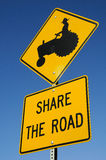 Tractor Sharing Signage. Sign for Sharing the Road with Tractors Royalty Free Stock Photo
