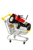 Tractor in shopping cart Royalty Free Stock Images