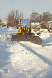Tractor shoveling snow Stock Images