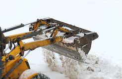Tractor shoveling snow. Stock Images
