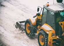 Tractor shoveling snow. Royalty Free Stock Photography