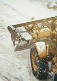 Tractor shoveling snow. Stock Photos