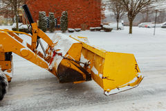 Tractor shoveling snow on the street. Stock Photos