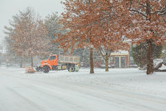 Tractor shoveling snow on the street. Stock Image