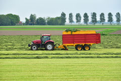 Tractor and silage wagon Royalty Free Stock Photos
