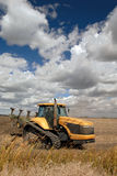 Tractor And Skies Royalty Free Stock Photo