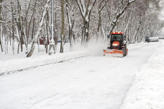 Tractor snow removal Royalty Free Stock Photos