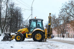 Tractor for snow removal is parked on a city street Stock Photo