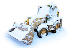 Tractor in the snow Royalty Free Stock Photos