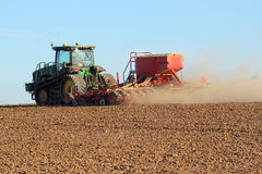 Tractor sowing or drilling new seed. Stock Photos