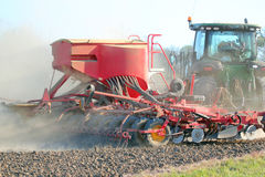 Tractor sowing or drilling seed. Royalty Free Stock Photos