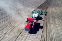 Tractor sowing in the field Royalty Free Stock Image