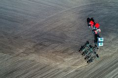 Tractor sowing in the field Stock Image