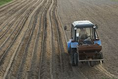 Tractor with sowing machine stock images