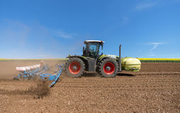 Tractor with sowing machine Royalty Free Stock Photos