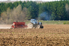 The tractor sowing seeds Stock Photography