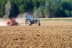 The tractor sowing seeds Royalty Free Stock Image