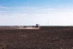 Tractor sowing seeds Stock Images