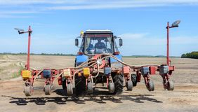 Tractor sows a field of cereals royalty free stock photos
