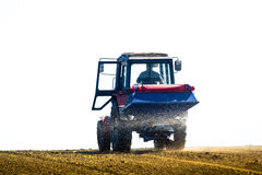 Tractor Spaying A Field In The Spring Royalty Free Stock Photo