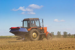 Tractor Spaying a field in the spring Stock Photos