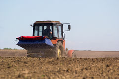 Tractor Spaying a field in the spring Stock Photo