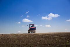 Tractor Spaying a field in the spring Royalty Free Stock Photos
